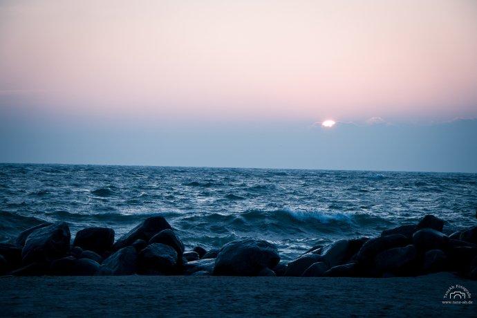 Ostsee Sonnenuntergang hinter Wolken